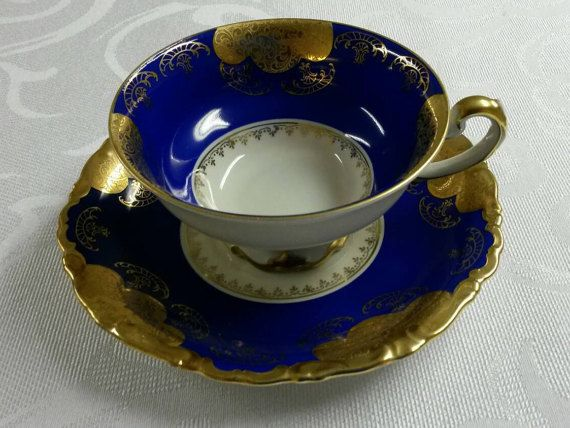 FREE LAYAWAY AVAILABLE! FREE SHIPPING!  For your consideration is this pretty cup and saucer from Alka Kunst of Western Germany US Zone. It is in wonderful vintage condition. So please excuse the shadows and glare from my camera! This piece is footed with much gilt. Its body is cobalt blue in color with an etched gold design. It also has heavy gold rims. It is absolutely stunning!! There are no cracks, chips, repairs or crazing.  The cup measures 2 1/4H x 4 3/16W and the saucer mea...