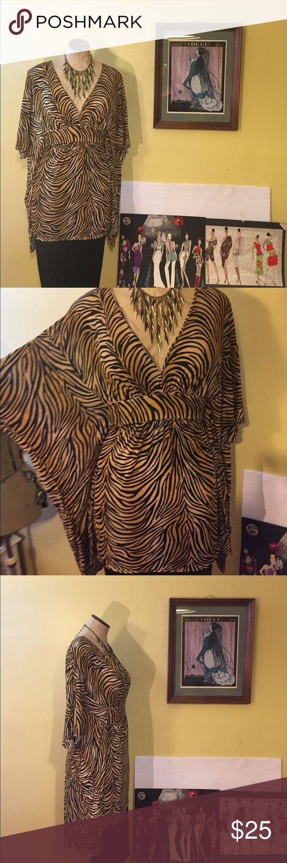 👁🐆BCBG MAXAZRIA ANIMAL TOP👁 This top is amazing!!! Great stretch, can complement any pant, skirt or leggings. If purchase full price you will receive a black pencil skirt. Size Junior L. But a medium, large and a small waist Xlarge can fit. Get your fall wardrobe excited!!! Now🈴 BCBGMaxAzria Tops Tunics