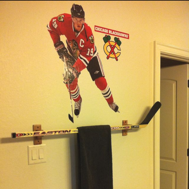 Made a towel bar using an old hockey stick