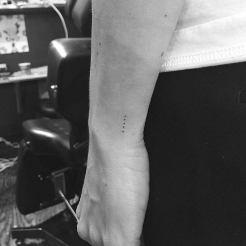 Five dots in a straight line on the left wrist. Tattoo artist:...