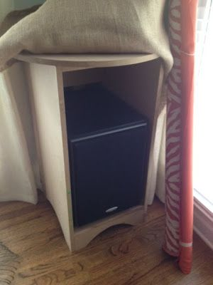 Hide your man's ugly tv speaker/subwoofer by building a skirted table on top and around it, add skirted tablecloth, voila! pretty!