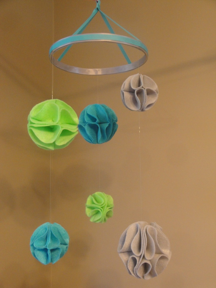 Pom-Pom Baby Mobile- Lime Green, Aqua Blue, and Gray Felt Nursery Mobile. $50.00, via Etsy.  I'm pretty sure I have pinned instructions on on how to make poems like these.  I could do this.