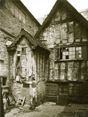 Marsh Farm House, Kirk's Yard, Nottingham, a timber framed house probably dating back to Tudor times. This picture was taken in 1923, shortly before much of this area was demolished.