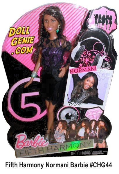 Fifth Harmony Normani Kordei Hamilton Barbie Doll # CHG44 - The sophisticated divas doll shines wearing a sleek fitted black pleather skirt, a lacy black and purple shirt finished off with touches of bling. Her chic look is accompanied by turquoise and silver accessories and a pair of studded stilettos.  https://www.dollgenie.com/profile-dg.php?id=3260