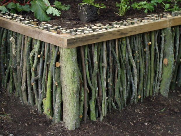 ACTUALLY I DID THINK OF SOMETHING JUST LIKE THIS WITH STICKS & BARK I COLLECT EVERYTIME I YARDEN! NOLAWEST***** More Garden Edging: 9 Creative Ideas! | The Garden Glove