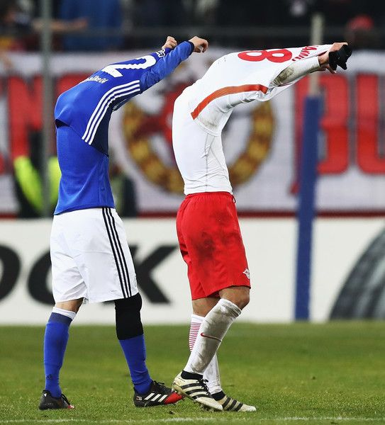 Atsuto Uchida of Schalke swaps shirts with Takumi Minamino of Salzburg at the end of the UEFA Europa League match between FC Salzburg and FC Schalke 04 at Red Bull Arena on December 8, 2016 in Salzburg, .