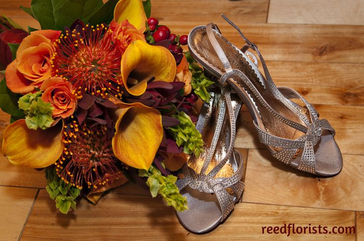 The brides sparkly heels reflect the colour and texture of this fall bouquet. Designed exclusively by our accomplished designers. reedsflorists.com