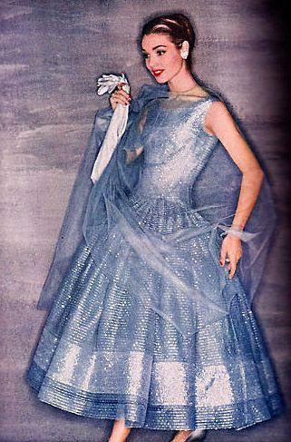vintage 1950s silver dress gown cocktail ballet length blue metallic shine lurex full skirt evening wear color photo print ad model magazine tulle wrap