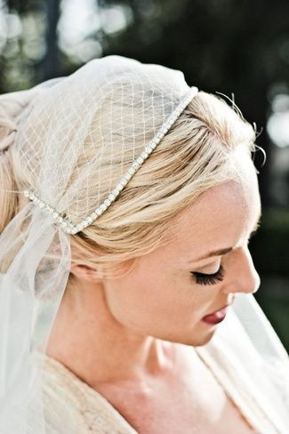 A fingertip-length cathedral-style Juliet Cap bridal veil made from illusion tulle, netting and adorned with rhinestones. {Available from: Veiled Beauty in California, US at $210.00 USD}