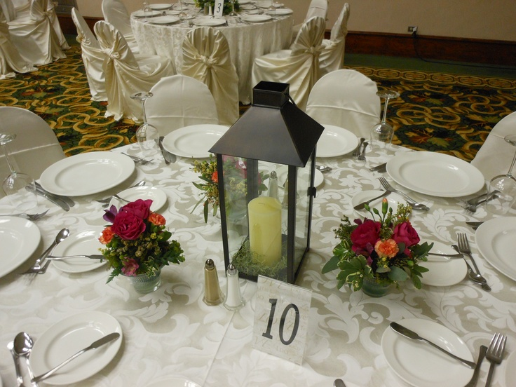 Wedding flowers table centerpiece lanterns and small