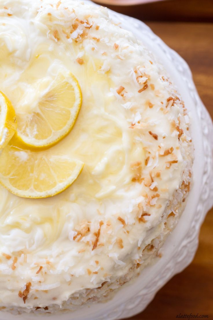 This classic coconut cake is filled lemon curd and topped with a lemon cream cheese frosting!   www.alattefood.com