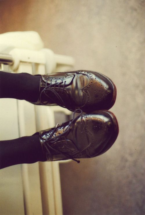 Brogues and black tights.
