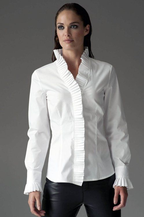 https://www.cityblis.com/6074/item/12545   CHRISTINA WHITE - $144 by The Shirt Company   The beautiful pleating around the Christina's stand collar and cuffs mark this elegant woman's shirt out from the crowd. Ideal for evening, tuck this statement shirt into a pair of silk or satin trousers and patent stilettos for a sharp chic look.  Shirt with pleated stand collar and cuf...   #Tops/Blouses