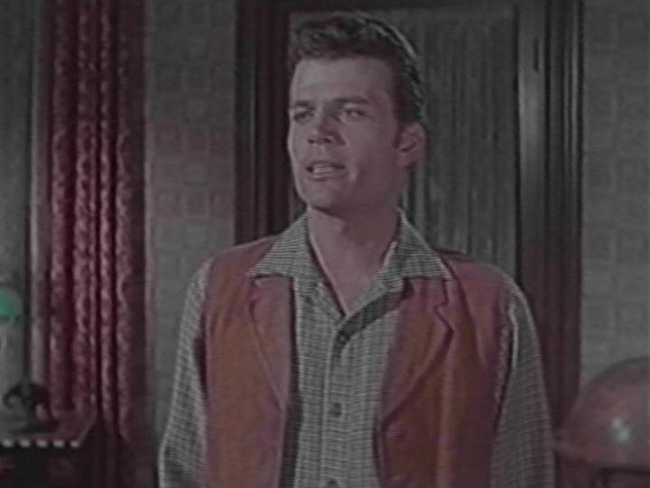 "Patrick Wayne as Devlin ""Dev"" Warren"