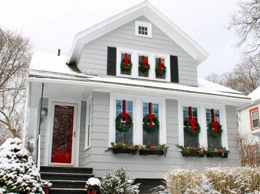 Classic xmas, wreath hanging on the red ribbon with a red bow and a lighted candle inside the window below the wreath. Description from pinterest.com. I searched for this on bing.com/images