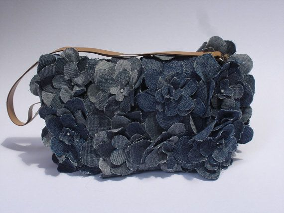 Eco friendly repurposed denim clutch bag, handmade/Impressive/stylish unique. $50.00, via Etsy.
