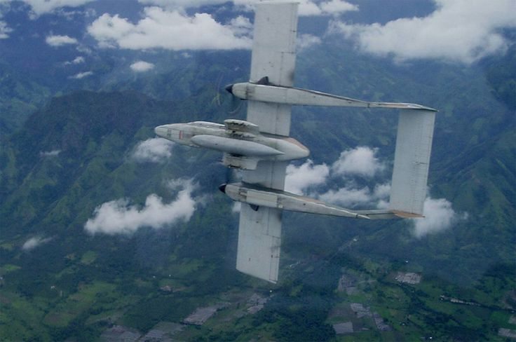 © PhAF - An OV-10 Bronco from the 16th Attack Eagles Squadron of the Philippine Air Force departs at the break above typical local landscapes