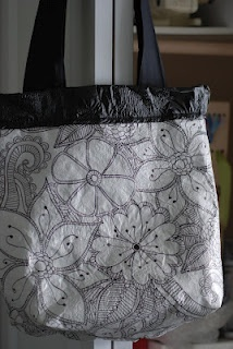 doodle with a sharpie on a white plastic tablecloth, and make a bag.