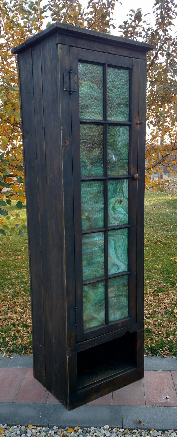 Upcycled Chimney Cupboard is made from 1900s wood from a little Country School near Red Lodge  MT(Jackson School) with an antique green slag glass window.