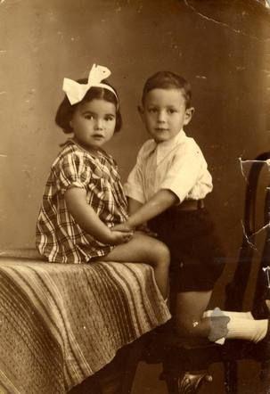 Anna Vleeschhouwer (sitting) Anna was sadly murdered in Auschwitz on September 3, 1943 at age 7. Anna was from Amsterdam, Netherlands.
