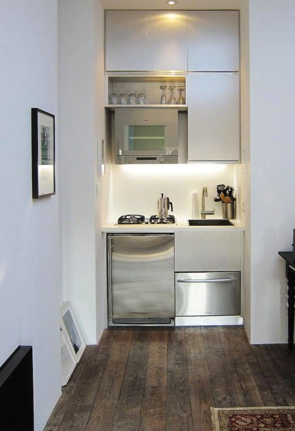 This tiny kitchen is the bees knees - perfect for little house or studio or guest cottage.  Lovin' the overhead dish drip tray.