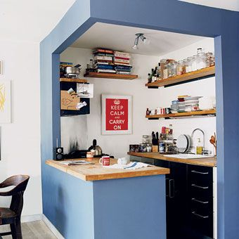 lovely small kitchen. Good use of colour and wood