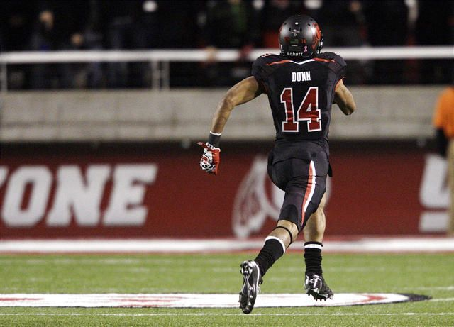 Utah Utes wide receiver Reggie Dunn (14) scores on his second kickoff return against Cal  in Salt Lake City Saturday, Oct. 27, 2012.
