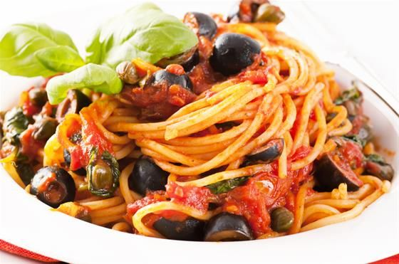 Spaghetti alla Puttanesca. Ingredients:  400g Spaghetti. 1/2 cup olive oil. 20g butter. 150g black olives. 2 salted anchovies, washed and chopped. 2 cloves garlic, crushed. 1tsp salted caper buds rinsed & drained. Italian parsley roughly chopped. 250g of canned peeled tomatoes. Salt & pepper to taste. #Recipe