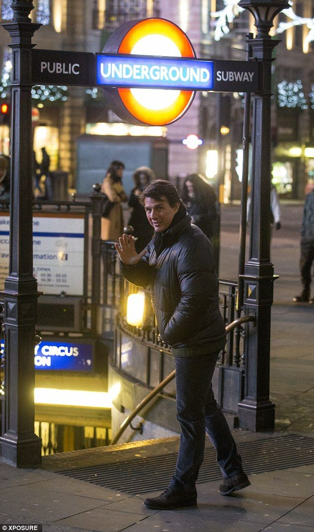 Tom Cruise chats with young assistant on MI5 set in London. Mission  Impossible