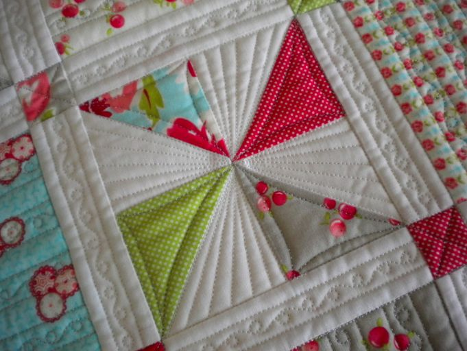 love the detailed quilting on this...I need to make a baby quilt to practice on