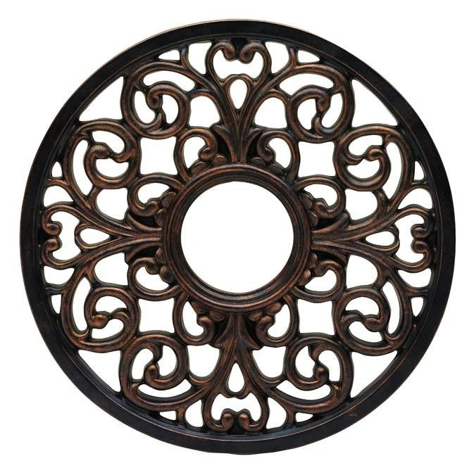 Add a winsome accent to your interior decor with the round Parisian scroll antique bronze finish ceiling medallion. The medallion features sophisticated filigree-style scroll ornamentation and an anti
