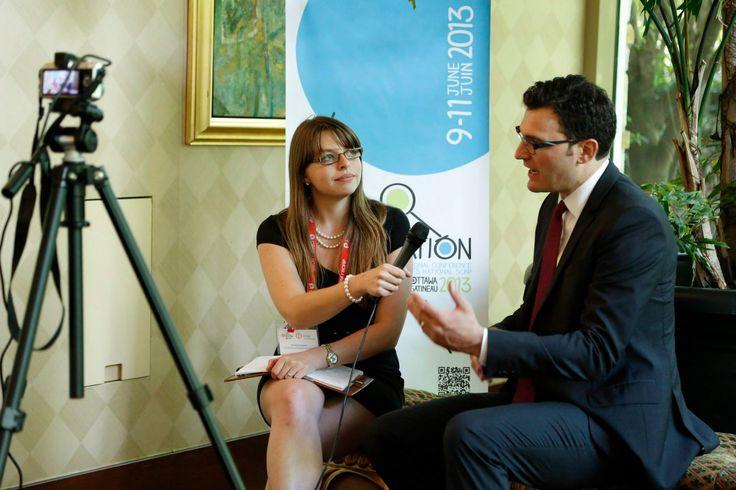 Co-host, Kristine Simpson, interviews Evan Solomon after his keynote.