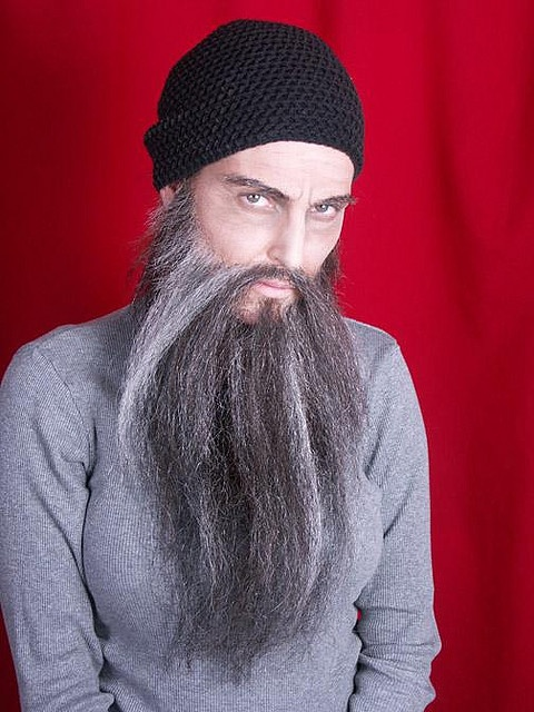 fake beard (=woman)