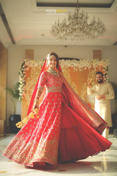 Bridal Lehenga - Bride in a Red Lehenga | WedMeGood | Twirling Bride in a Coral Red   Jacket with a Plain Lehenga  #wedmegood #indianbride #indianwedding #bridal #lehenga #coral #twirling #bridallehenga #weddinglehenga