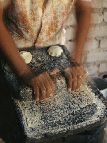 A Cora Woman Grinds Corn for Tortillas | Maria Stenzel via Art.com