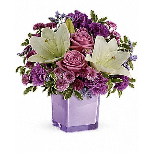 Eager to please! This luxurious bouquet of lavender roses and snow white lilies is a fabulously fragrant way to tickle their fancy!Lavender roses, white asiatic lilies, purple carnations, lavender carnations, purple button spray chrysanthemums and lavender button spray. Send #Flowers to #Philadelphia