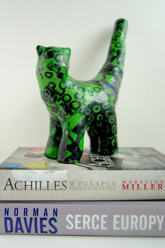 Green cat covered with silk figurine on the table. by ankaGilding