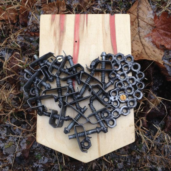 A simple reminder for someone you care about. Welded steel heart assembled from salvaged hex-nuts and fasteners on spalted box elder. Clear-coated