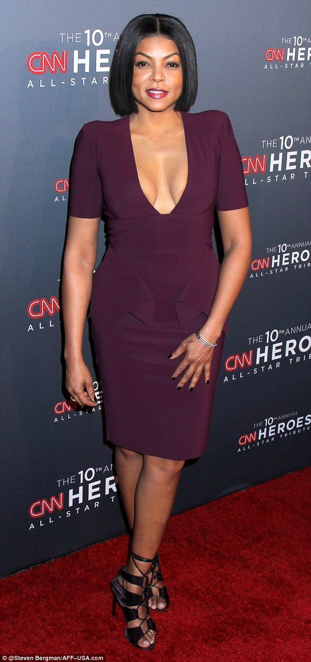 Showstopper! Taraji P. Henson was a standout on the CNN Heroes red carpet Sunday in New York in a plum-colored dress with a plunging neckline