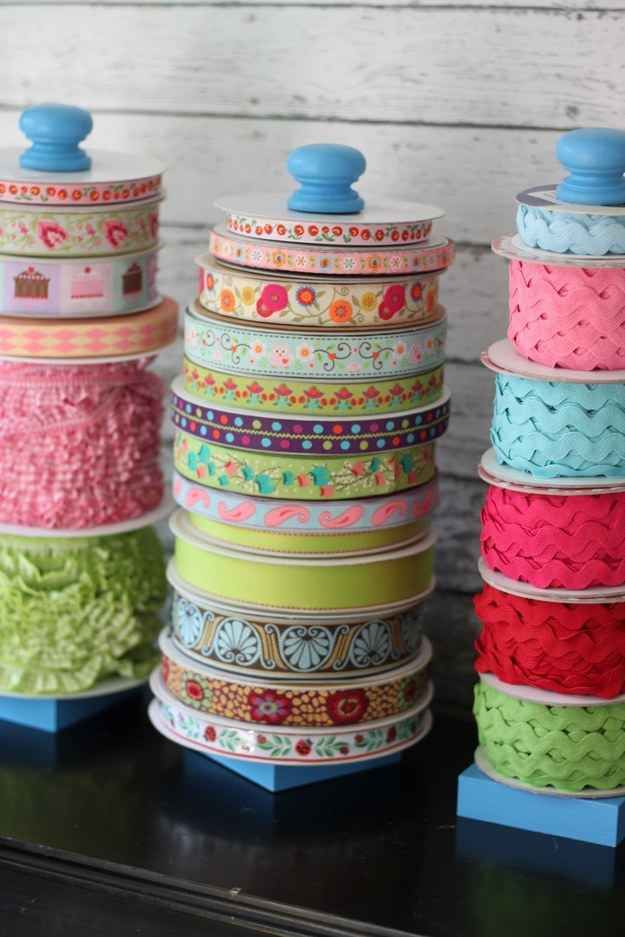 Paper towel holders can easily become ribbon and ric rac holders. | 45 Organization Hacks To Transform Your Craft Room