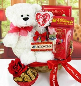 Perfect combination and a gift that will be welcomed if she has a sweet tooth and loves teddy bears. The ribbon can be personalized for a super sweet surprise and comes with free shipping. Only $50.95 from http://pressentz.com/wp-content/uploads/2013/11/BSGB-2T.jpg