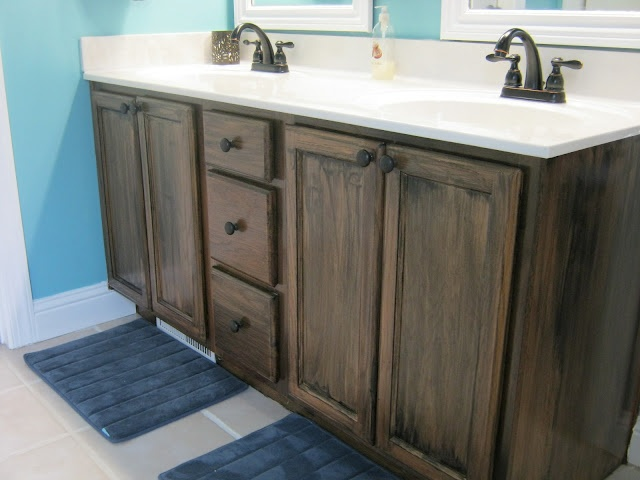 Stain (instead of paint) builder grade oak cabinets-also check out bronzing the metal hardware. had no idea you could do that.