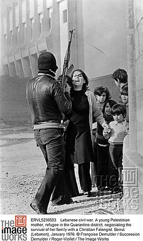 Lebanese civil war. A young Palestinian mother, refugee in the Quarantine district, negociating the survival of her family with a Christian Falangist. Beirut (Lebanon), January 1976. © Françoise Demulder