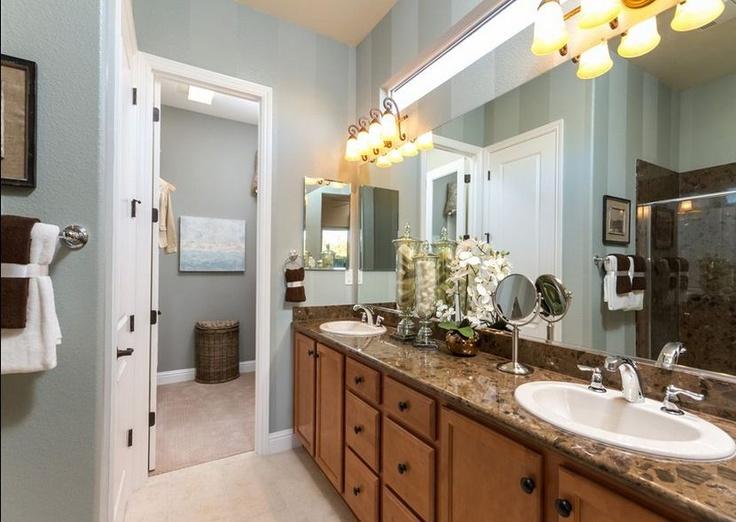 Light colors, plenty of storage space in Del Webb bathrooms!