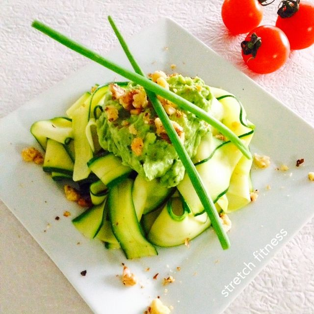 Zucchini pappardelle topped with an avocado mix of garlic, coriander and lime juice. So good!