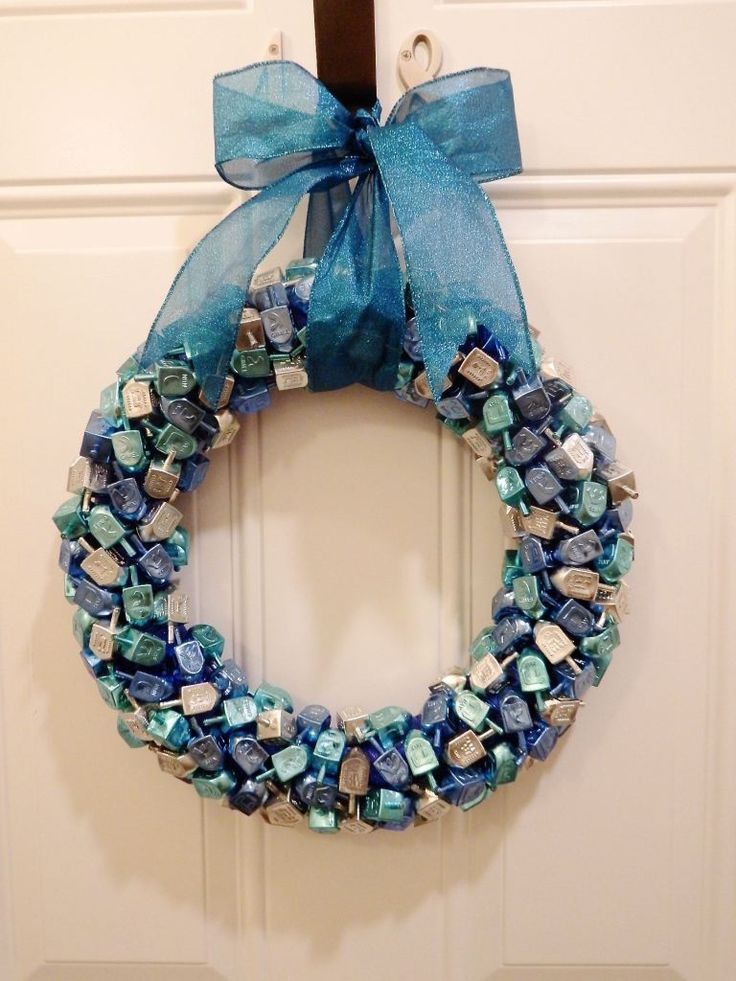 I am so excited about my new Hanukkah wreath, I'm spinning in circles. You know, like a dreidel. Hardy har har. I first thought of this idea while we were living in Tokyo, but knew it would b…