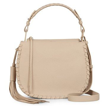 mori leather crossbody bag by Allsaints. Whipstitched detailing and a classic saddle silhouette add a vintage-Western vibe to a compact crossbody bag crafted from supple suede and topped with a long, lush tassel for swingy movement. Style Name: Allsaints Mori Leather Crossbody ... #allsaints #bags