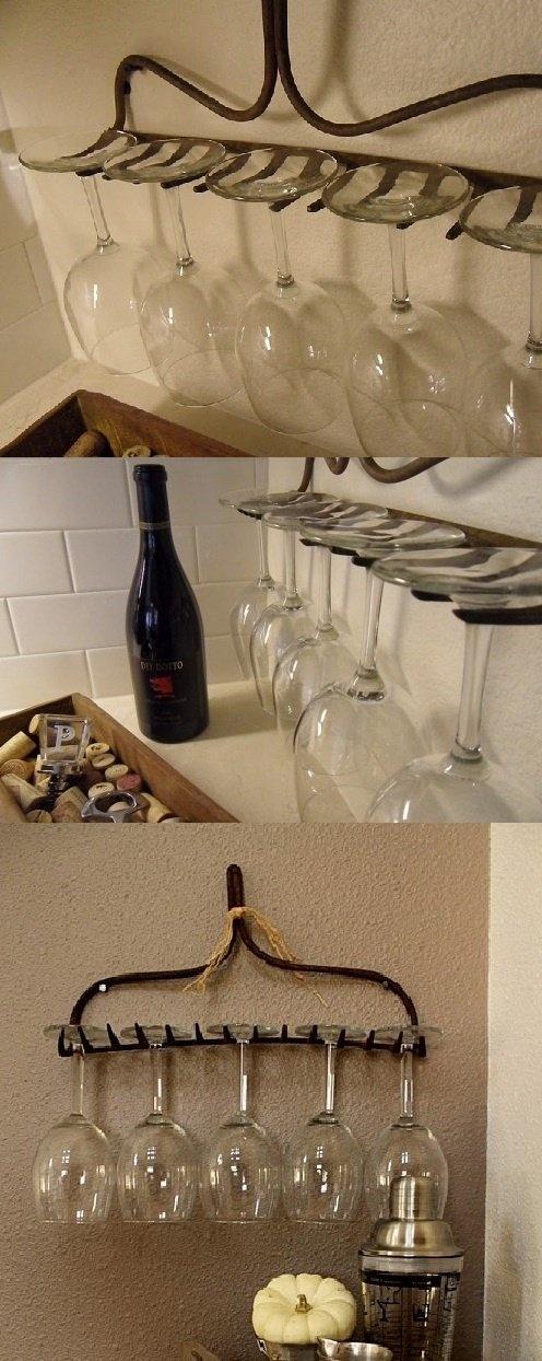 An upside down rake used as a wine glass holder