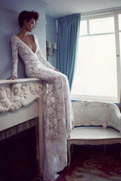 Fitted long sleeve lace wedding dress with a plunging neckline...this is perfect!