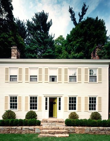 Albert Hadley chose a soft off-white and a pale gray for the clapboard and shutters of this 1820 Colonial in New Jersey.